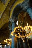 ISTANBUL, TURKEY: Hagia Sophia interior. Old metal chandelier with light bulbs between columns. Hagia Sophia is the greatest monument of Byzantine Culture stock images