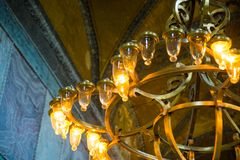 ISTANBUL, TURKEY: Hagia Sophia interior. Old metal chandelier with light bulbs. Hagia Sophia is the greatest monument of Byzantine Culture stock photo