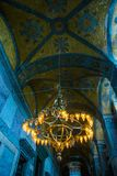 ISTANBUL, TURKEY: Hagia Sophia interior. Old metal chandelier with light bulbs. Hagia Sophia is the greatest monument of Byzantine Culture stock photography