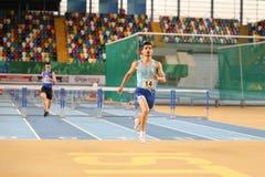 Turkish Athletic Federation Olympic Threshold Indoor Competition. ISTANBUL, TURKEY - JANUARY 07, 2018: Athletes running 60 metres hurdles during Turkish Athletic Stock Images