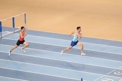 Turkish Athletic Federation Olympic Threshold Indoor Competition. ISTANBUL, TURKEY - JANUARY 14, 2018: Athletes running 60 metres hurdles during Turkish Athletic Stock Photo