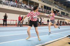 Turkcell Turkish U20 Indoor Athletics Championships. ISTANBUL, TURKEY - JANUARY 28, 2018: Athletes running 4x400 metres during Turkcell Turkish U20 Indoor Stock Images