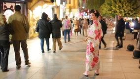 ISTANBUL, TURKEY - JANUARY 2013: Japanese geisha samurai. With sword outside at night Royalty Free Stock Photography