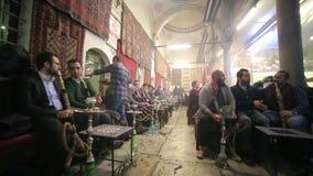 ISTANBUL, TURKEY - JANUARY 2014: People smoking shisha. At Nargile Cafe, Shisha place around Grand Bazaar stock footage