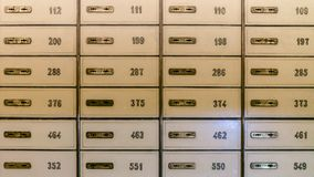 Rows of safety deposit boxes in a bank vault or security lockers Royalty Free Stock Image