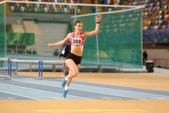 Turkish Athletic Federation Olympic Threshold Indoor Competition. ISTANBUL, TURKEY - JANUARY 14, 2018: Undefined athlete running 60 metres hurdles during Turkish Stock Image