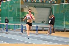 Turkish Athletic Federation Olympic Threshold Indoor Competition. ISTANBUL, TURKEY - JANUARY 14, 2018: Undefined athlete running 60 metres hurdles during Turkish Stock Photo