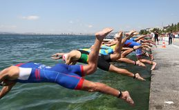 Istanbul Beylikduzu ETU Triathlon European Cup 2017. ISTANBUL, TURKEY - JULY 30, 2017: Athletes competing in swimming component of Istanbul Beylikduzu ETU Royalty Free Stock Photo