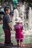 ISTANBUL, TURKEY - JULY 07: Kids over a park fountain on July 07 Stock Photography