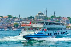Police motorboat and pleasure boat. Istanbul, Turkey - July 17, 2018: Police motorboat and pleasure boat in the Golden Horn inlet in Istanbul stock image