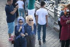Women in hijab walking on the embankment Stock Photo