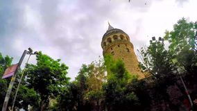 ISTANBUL, TURKEY- JUN 09 2015: Galata Tower is a medieval stone tower in the Galata/Karaköy quarter of Istanbul stock video