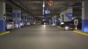 ISTANBUL - TURKEY 8 June 2016 / Cars on underground parking inside building stock video footage