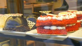 Istanbul, Turkey - June 11, 2019: Designer cakes and cakes on the counter of expensive pastry and sweets store stock video footage