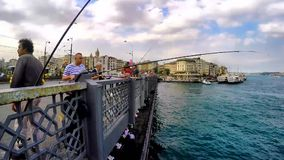 ISTANBUL, TURKEY- JUNE 9 2015: Fisherman fishing at Galata bridge in Istanbul, Turkey. The first bridge on this place was build 16 stock video