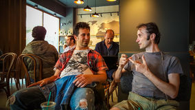 Istanbul, Turkey - June 02, 2017: Friends at Starbucks coffee shop in Istanbul. Starbucks Corporation is an American global coffee company and coffeehouse Stock Image