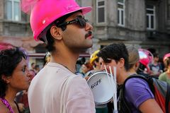 ISTANBUL, TURKEY, JUNE 24, 2013: a man with pink hat marches during the LGBT Lesbian, Gay, Bisexual, Transsexual pride in Istikl. A man with pink hat marches stock images