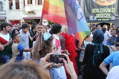 LGBT Lesbian, Gay, Bisexual, Transsexual pride march in Istiklal Street. ISTANBUL, TURKEY, JUNE 24, 2013: a man with pink hat marches during the LGBT Lesbian stock photos