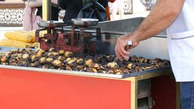 Istanbul, Turkey - June 12, 2019: Roasted chestnuts on a city street. Street food, the hot cooked chestnuts stock footage