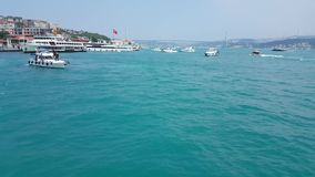 Cruising in a ferry with seascape view of Bosphorus in Istanbul. Istanbul, Turkey - June 03, 2017: View of Bosphorus while cruising in a ferry stock video footage