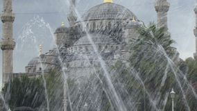 Istanbul Turkey fountain and Sultan Ahmet Mosque. Blue Mosque in Istanbul. stock video