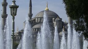 Istanbul Turkey fountain and Sultan Ahmet Mosque. Blue Mosque in Istanbul. stock video footage