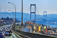 ISTANBUL, TURKEY - MARCH 24, 2012: Bridge over the Bosphorus. royalty free stock image
