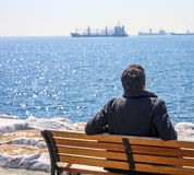 Istanbul, Turkey - March 28, 2017: A lonely man on the bench at istanbul Beach. A lonely man on the bench at istanbul Beach Stock Image