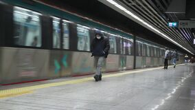 A man with a protective mask is waiting at the metro station. Istanbul subway, which remained empty as a result of measures taken