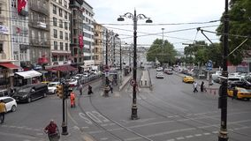 Sirkeci District with tramway, car and human traffic in Istanbul, Turkey. Istanbul, Turkey - May 2018: Ankara Street at Sirkeci District. A tram system, tramway stock video footage