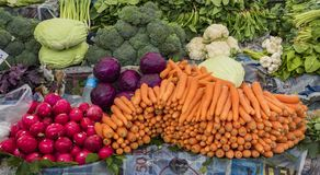 Istanbul, Turkey  May 31, 2016 - Carrots, radishes, onions and other vegetables are on display stock photography