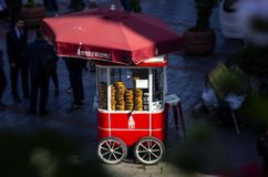 ISTANBUL, TURKEY - May 2, 2018: Famous tourist place Galata tower and Turkish Bagel Simit sale on nostalgia red car in Istanbul i stock photography