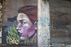 Istanbul, Turkey -May 25, 2019: Hand-drawn illustration of shop shutters on streets of Balat. Colored and graffiti stock images