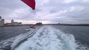 Istanbul ferry sailing in Bosphorus with with waving Turkish flag stock footage