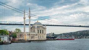 Ortakoy mosque and Bosphorus Bridge connecting Europe and Asia continents, Istanbul, Turkey. Istanbul, Turkey - May 2017: Ortakoy mosque and Bosphorus Bridge Royalty Free Stock Photo