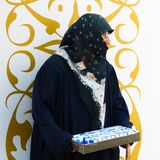 Tissue saleswoman with classical muslim clothes