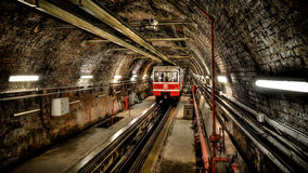 Istanbul, Turkey - May 11, 2013: Tunel subway between Karakoy and Tunel Square, the second oldest funicular metro line in the worl. Tunel subway between Karakoy stock photos