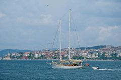 View of a yacht sailing up the Bosphorus in Istanbul stock images