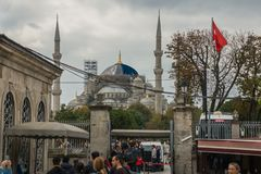 Istanbul, Turkey: Minaret of the Blue mosque between the trees royalty free stock image