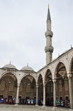 Istanbul, Turkey - November 22, 2014: The courtyard of Sultan Ahmed Mosque (popularly known as the Blue Mosque). Arches and minaret in the courtyard of Blue Stock Photo