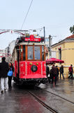 Istanbul, Turkey - November 23, 2014: Red tram on Istiklal Street in Istanbul. Red tram is the hallmark of Istiklal Street Stock Image