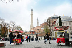 Istanbul, Turkey - November 22: A view of Hagia Sophia and the area with tourists, citizens and street sellers. Istanbul cityscape. View of the Hagia Sophia Stock Image