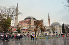 Istanbul, Turkey - November 22: A view of Hagia Sophia and the area with tourists waiting to enter on November 22, 2014 in Istambu. A view of the museum complex Stock Images