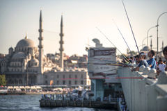 ISTANBUL, TURKEY - OCT. 09: Fishermen on Galata bridge of Istamb Stock Photography