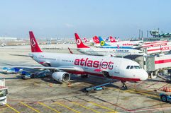 ISTANBUL, TURKEY - October, 2013: Airplanes at Istanbul Ataturk. Airport in Istanbul, Turkey. A view from Istanbul Ataturk airport. Atlasjet airline in the Royalty Free Stock Photography