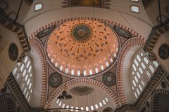 Arch with mosaic on ceiling in ancient suleymaniye mosque in Istanbul, Turkey. ISTANBUL, TURKEY - OCTOBER 09, 2015: arch with mosaic on ceiling in ancient Stock Photos