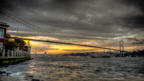 Istanbul, Turkey - 22 October, 2012: Bosphorus bridge connecting Asia and Europe on a cloudy evening, Istanbul, Turkey. The Bosphorus Bridge, also called the Stock Image