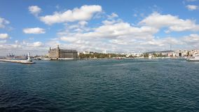 Haydarpasa railway station with a ferry sailing infront. The building is being restored after a roof fire stock video