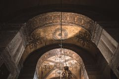 Low angle view of arch in illuminated suleymaniye mosque. ISTANBUL, TURKEY - OCTOBER 09, 2015: low angle view of arch in illuminated suleymaniye mosque Royalty Free Stock Photos