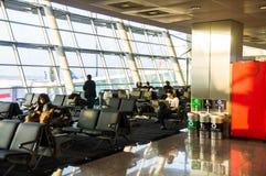ISTANBUL, TURKEY - October, 2013: Passengers at Istanbul Ataturk. Airport waiting area Stock Image